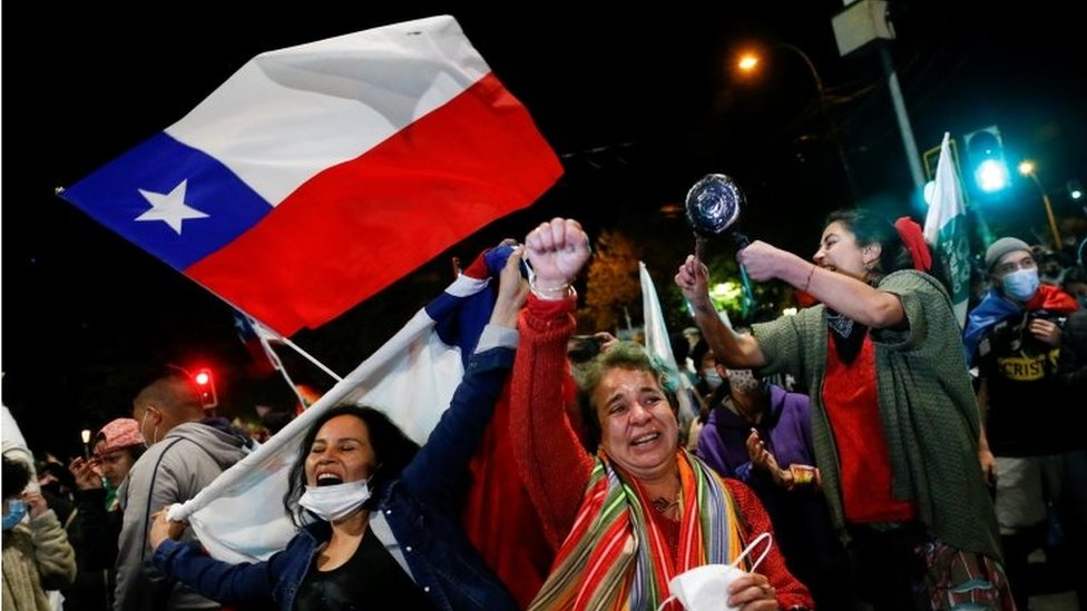 "Supporters of the ""I Approve"" option react after hearing the results of the referendum on a new Chilean constitution in Valparaiso, Chile, October 25, 2020."