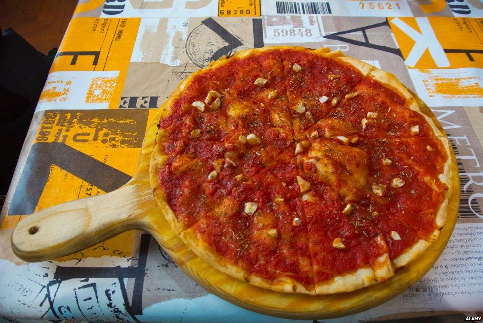 A classic Marinara pizza - with a tomato base and fresh garlic