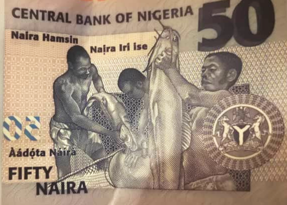A 50 naira note with Roman script in English, Igbo, Hausa and Yoruba