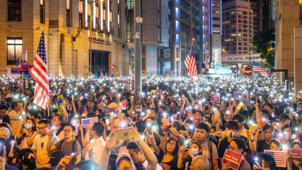 Thousands of protesters rallied on Monday in support of the Hong Kong Human Rights and Democracy Act