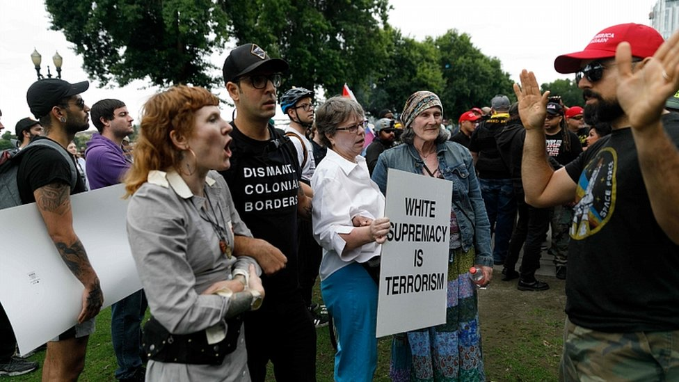 Counter-demonstrators (L) confront alt-right groups during a rally at Tom McCall Waterfront Park on August 17, 2019 in Portland, Oregon