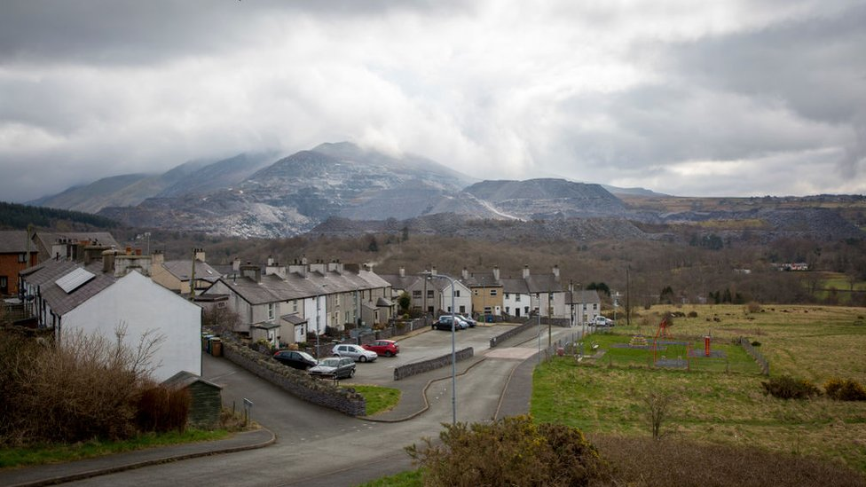 Bethesda today, terraced houses with views of the quarry workings behind them in the distance