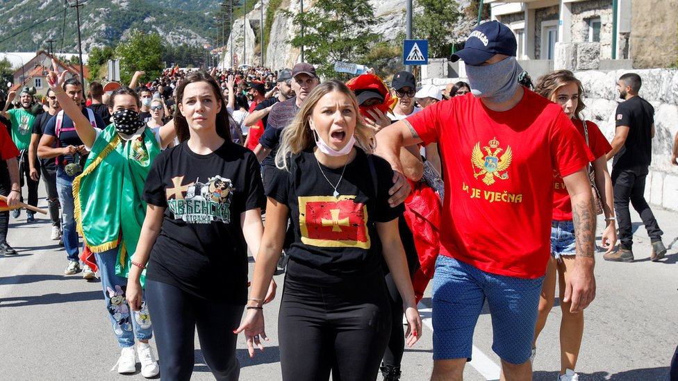 Demonstrators take part in a protest against enthronement of Bishop Joanikije in Cetinje