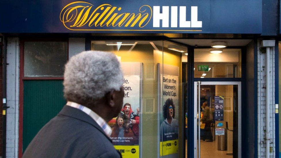 A man looks at a William Hill betting shop