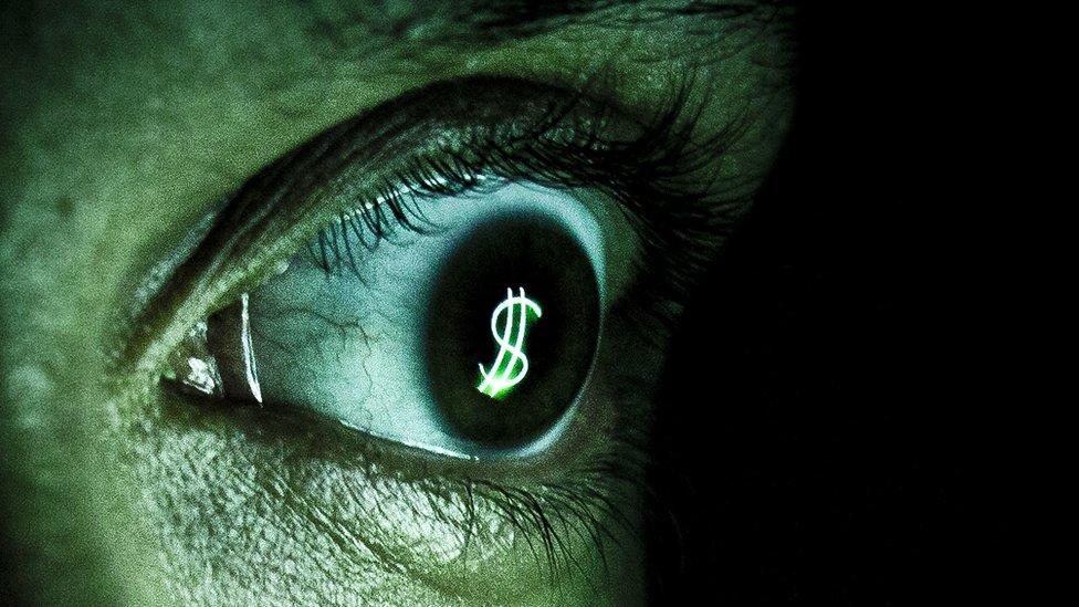 Ojo con signo de dinero