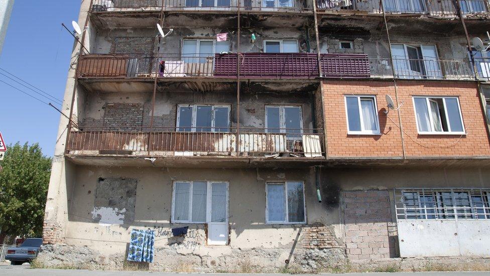 An apartment block in Tskhinvali still bears the scars of war