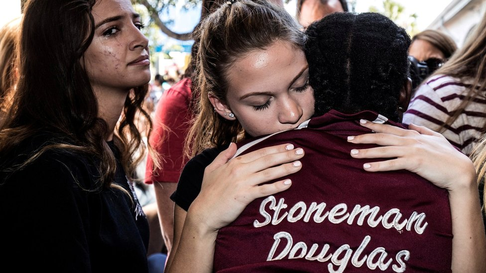 Students from Marjory Stoneman Douglas High School attend a memorial following a school shooting incident in Parkland, Florida