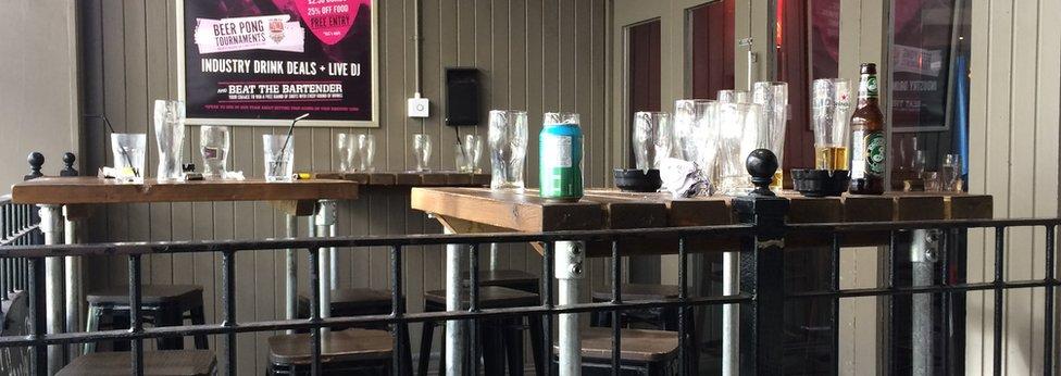 Empty glasses outside bar