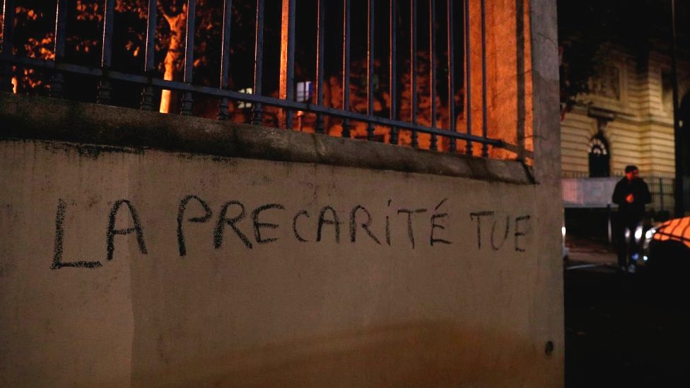 """The phrase meaning """"insecurity kills"""" spray-painted on a wall of the higher education ministry in Paris"""