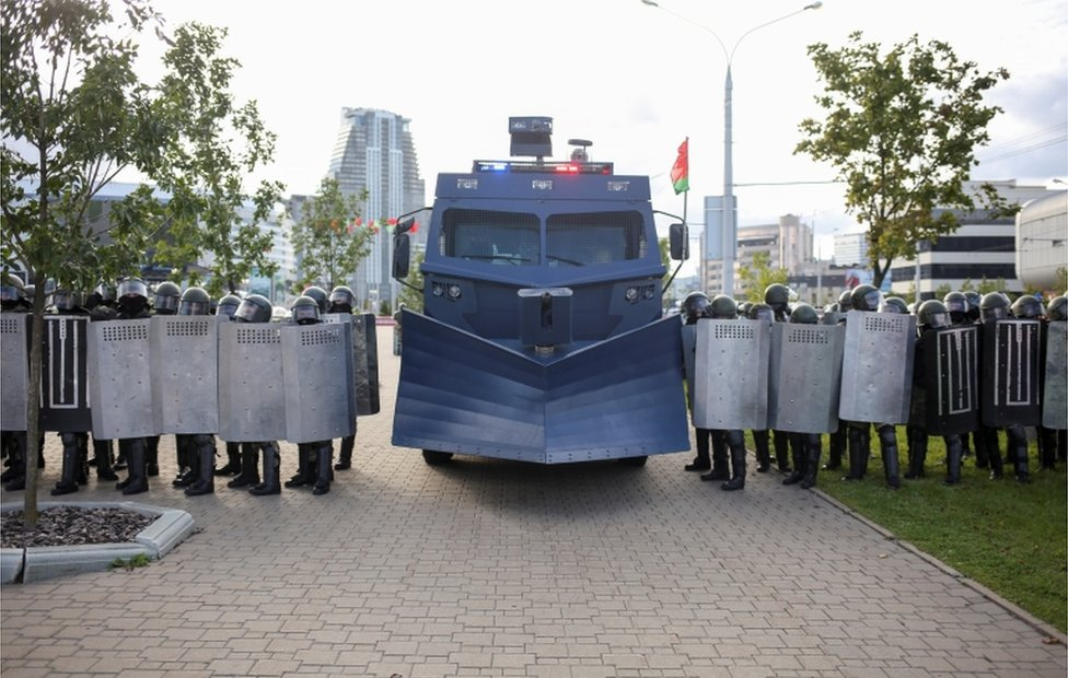 Belarusian riot police with snow-plough-like crowd control vehicle