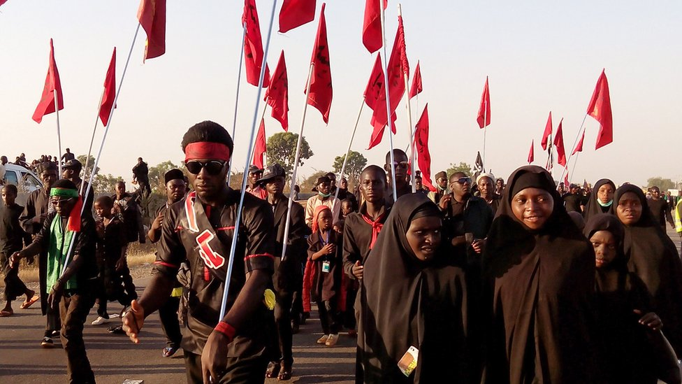 Shia Muslims march on the highway during a symbolic procession commemorating the 40th anniversary of the Ashura religious ceremony on 2 November 2015 in the village of Dakasoye, northern Nigeria