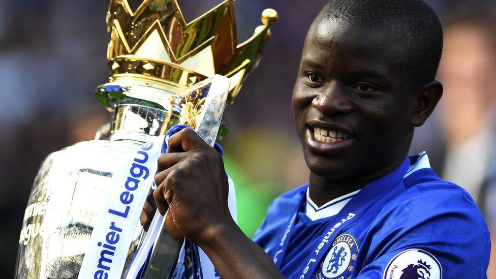 N'Golo Kante lifts the Premier League trophy