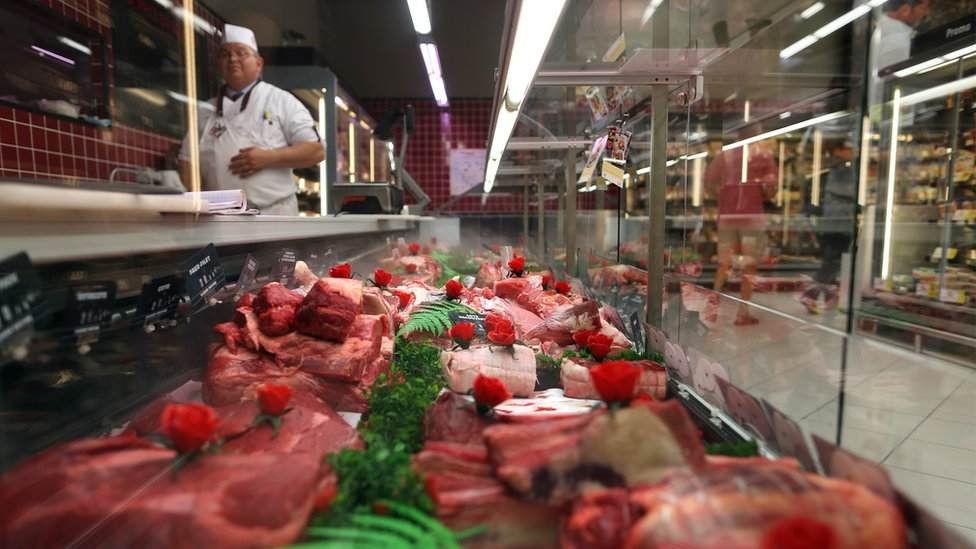 Meat is displayed in a French supermarket
