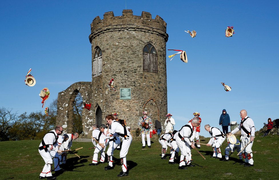 Leicester Morrismen throw their hats during May Day celebrations at Bradgate Park in Newtown Linford, UK May 1, 2018.