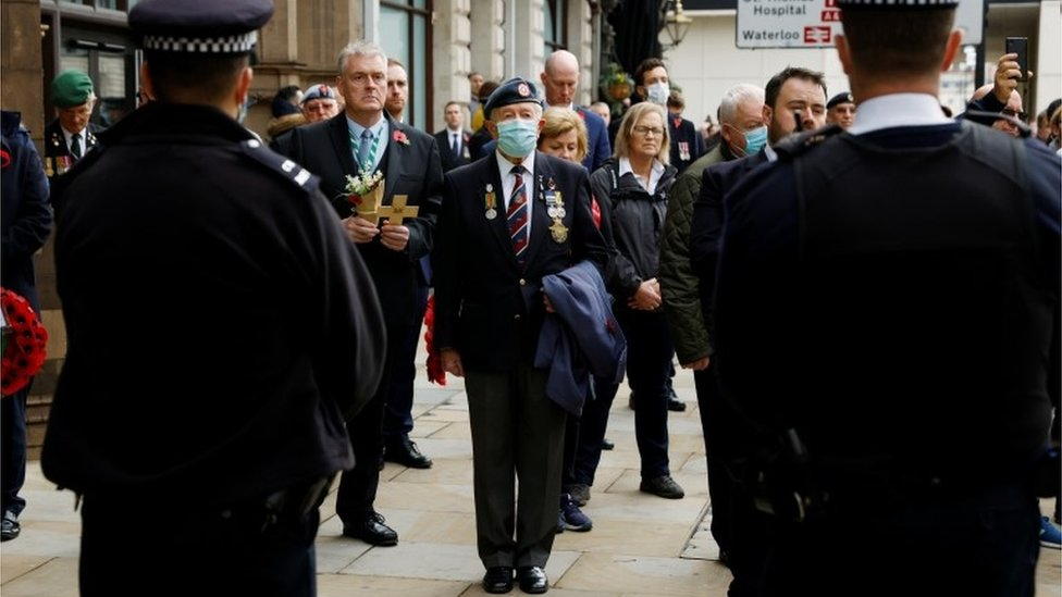 """Members of the public and veterans observe two minute""""s of silence, away from the Cenotaph"""