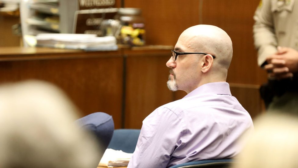 "Alleged serial killer Michael Gargiulo, known as the ""Hollywood Ripper,"" listens as Ashton Kutcher testifies during Gargiulo's trial of at the Clara Shortridge Foltz Criminal Justice Center on May 29, 2019 in Los Angeles, California"