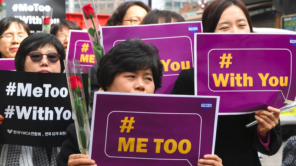 South Korean demonstrators hold banners during a rally to mark International Women