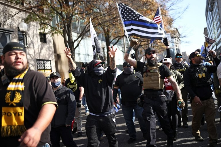 Members of far-right, anti-immigrant group Proud Boys marched through downtown Washington. Pic - Reuters
