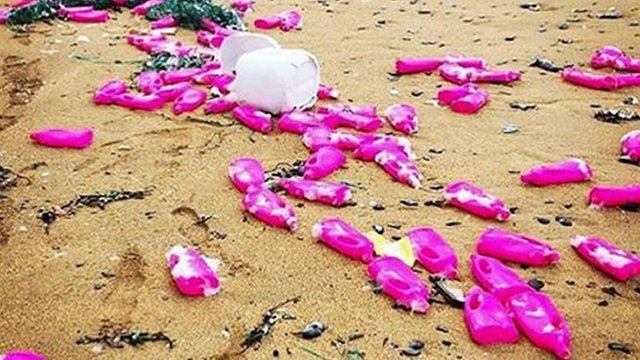 Pink bottles wash up on Cornish coast