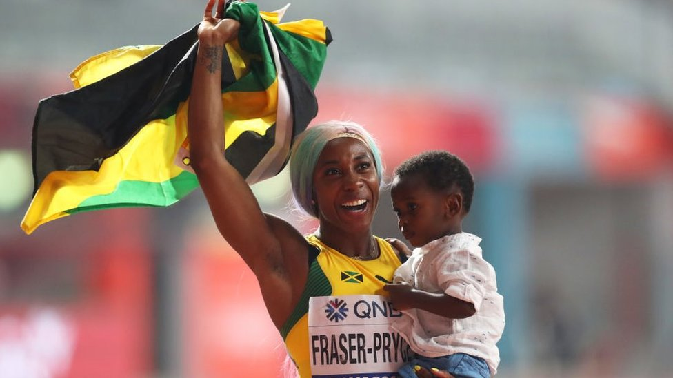 Shelley-Ann Fraser-Price with her son at the Doha 2019 IAAF World Athletics Championships