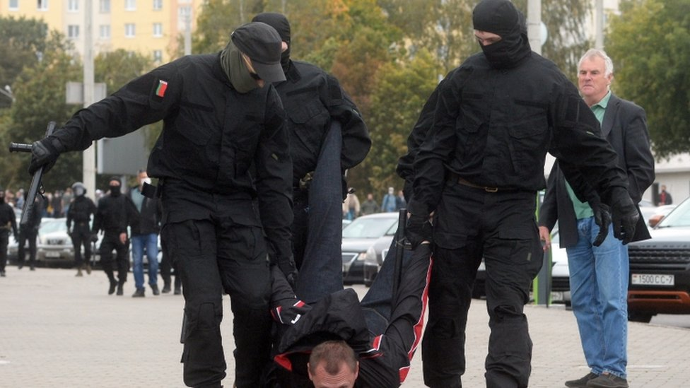 Police detain a protester in Minsk on 27 September 2020