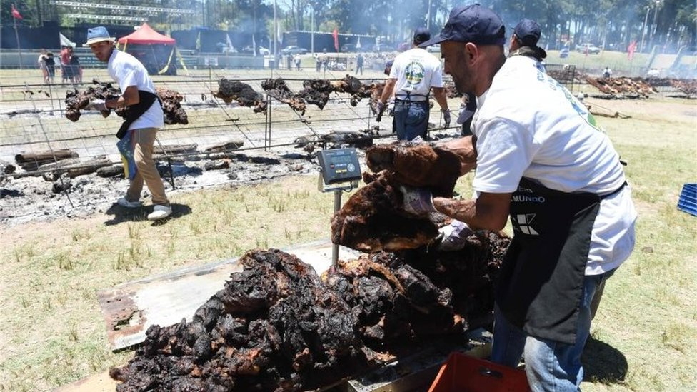 """Cooks weigh the beef to reach a total of 16,500 kg, in Rodo Park in Minas, Uruguay, 120 km from Montevideo, in an attempt to break the Guinness record for """"The World"""" s Biggest Barbecue"""", on December 10, 201"""