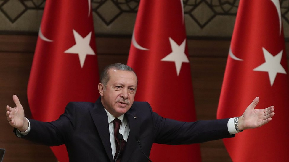 Turkish President Recep Tayyip Erdogan gestures as he speaks during a meeting in Ankara