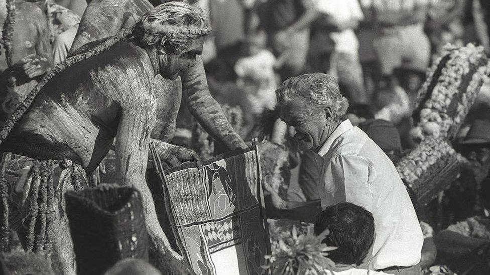 Bob Hawke receives the Barunga Statement, a landmark document, from an Aboriginal elder in 1988
