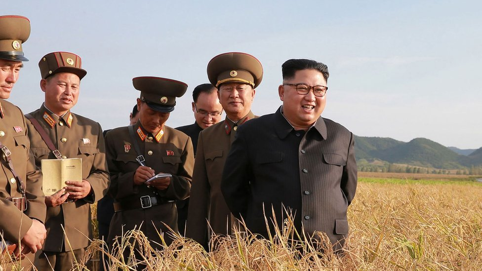 """This undated picture released from North Korea""""s official Korean Central News Agency (KCNA) on September 30, 2017 shows North Korean leader Kim Jong-Un (R) visiting Farm No. 1116 under Korean People""""s Army (KPA) Unit 810 at an undisclosed location"""