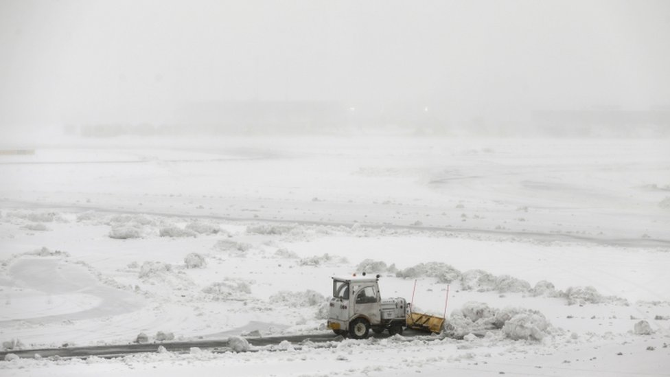 Ploughs work to clear the runways at Newark International Airport
