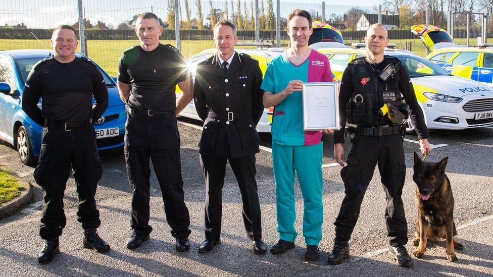 Axle receives his award