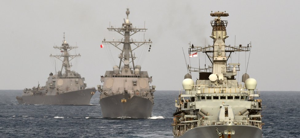 A British Naval ship at sea with Bahraini vessels