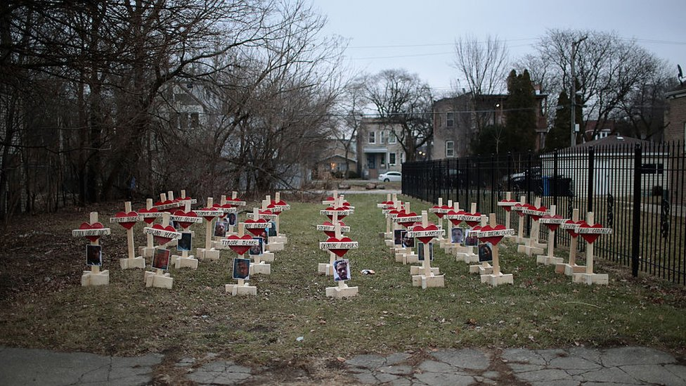 Forty-three crosses sit in a vacant lot in the Englewood neighborhood on January 23, 2017 in Chicago, Illinois.