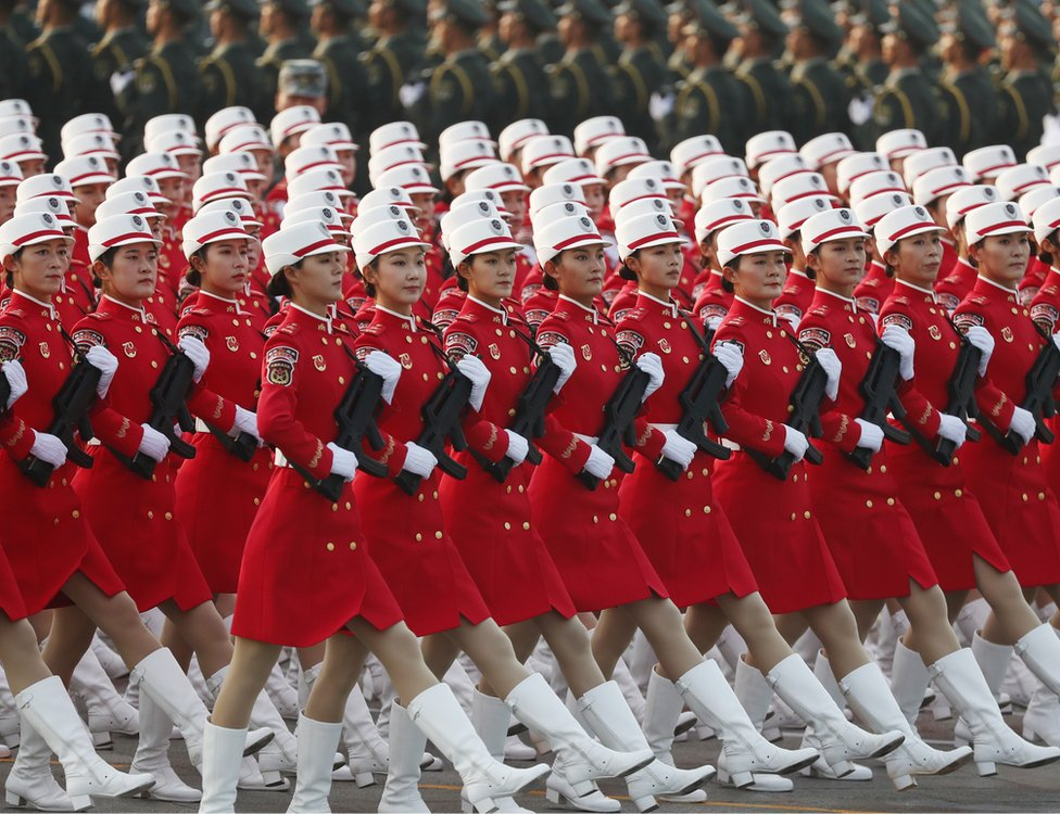 Chinese women troops march during a military parade in Tiananmen Square in Beijing on 1 October 2019 marking the 70th anniversary of the founding of the People's Republic of China.