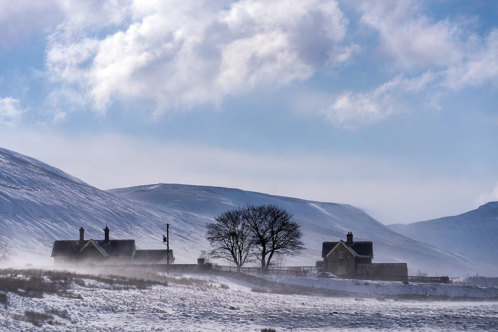 The sun shines over the snow covered dales of Ribble Valley near Ribblehead