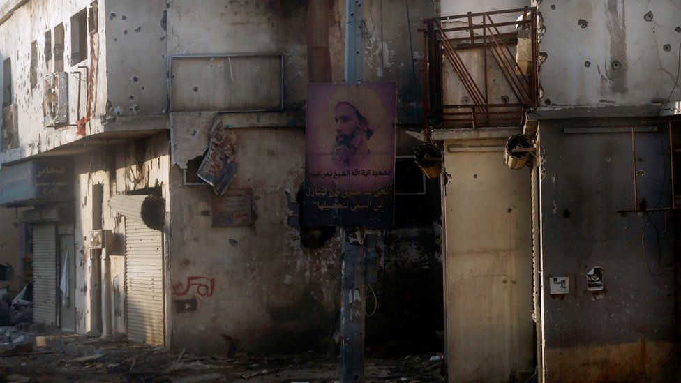 A poster mourning the executed cleric Sheikh Nimr al-Nimr hangs on a lamppost in Awamiya, Saudi Arabia (9 August 2017)