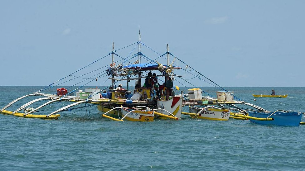This photo taken on June 16, 2016 shows a fishing vessel anchored at the mouth of the South China Sea off the town of Infanta in Pangasinan province, as they wait for their fishing expedition to Scarborough Shoal.