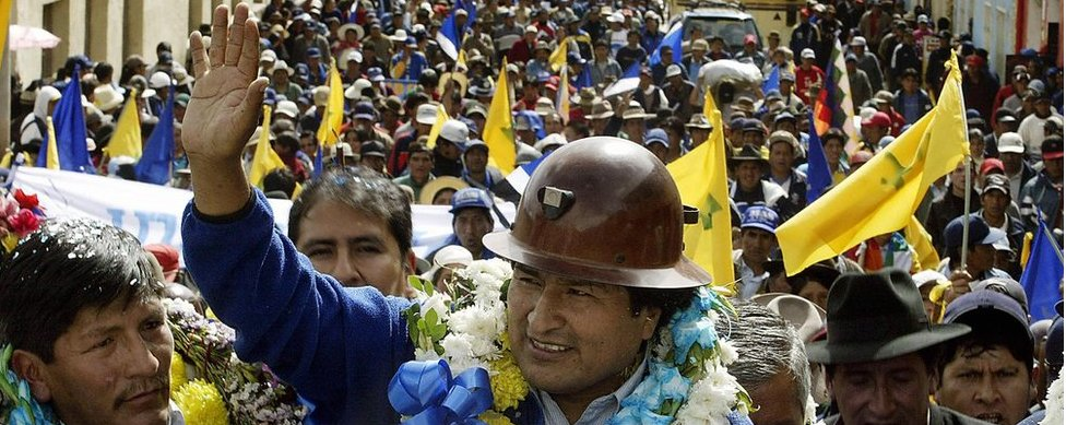 Evo Morales waves to supporters in Oruro, Bolivia, in October 2005 during a his presidential election campaign