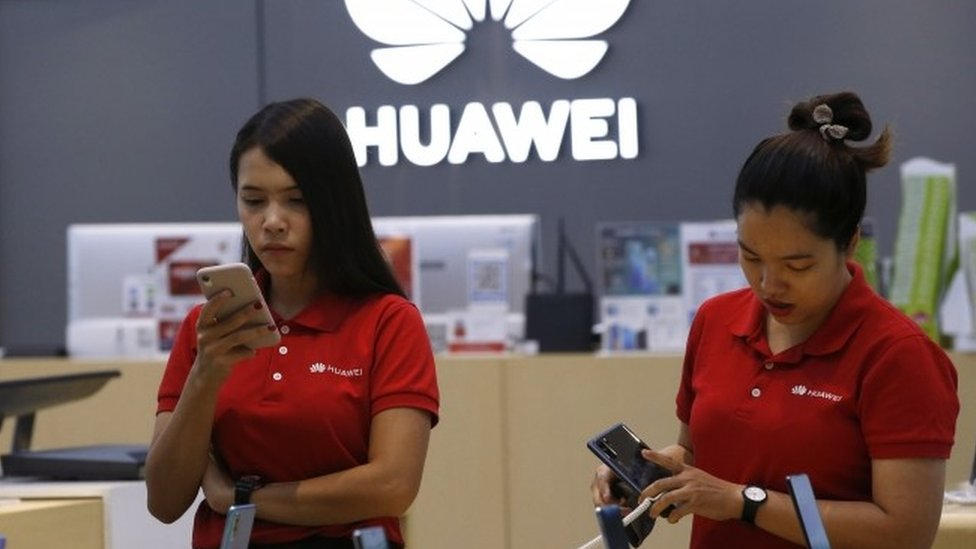 Shop assistants with Huawei products