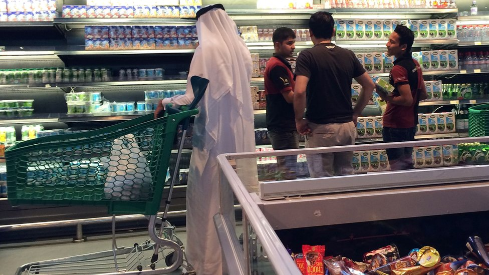 Customers are seen shopping at the al-Meera market in Doha on 10 June 2017