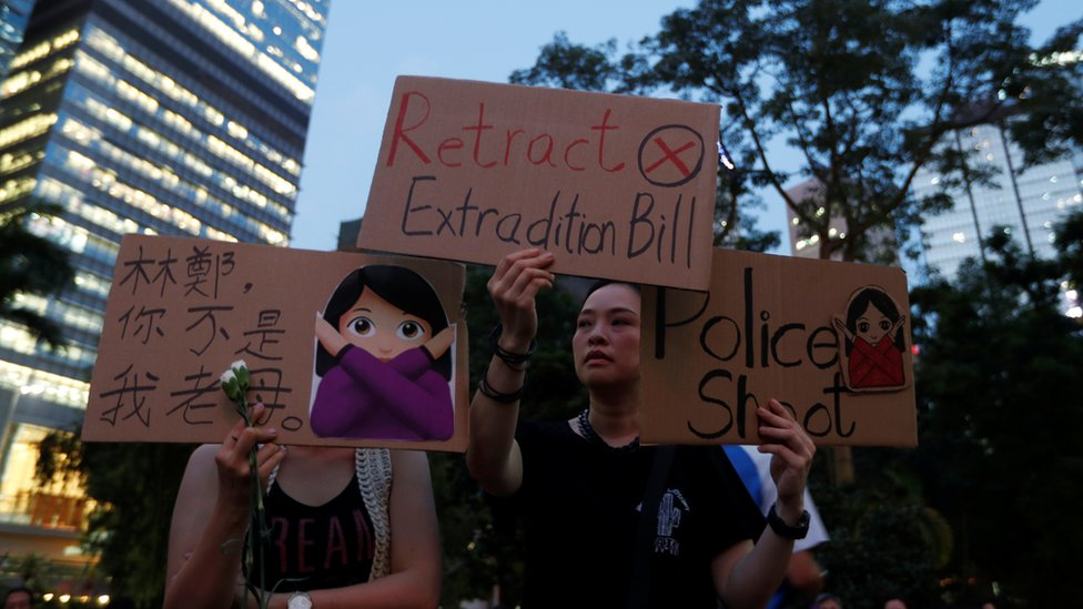 People attend a rally in support of demonstrators protesting against the proposed extradition bill with China, in Hong Kong