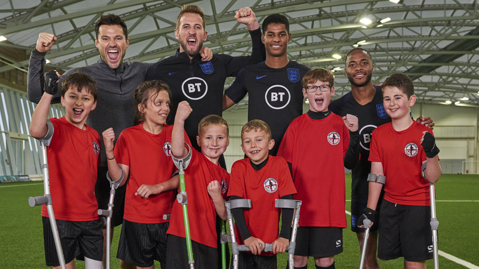 Children from the England Amputee Football Association with Mark Wright, Harry Kane, Marcus Rashford, Raheem Sterling