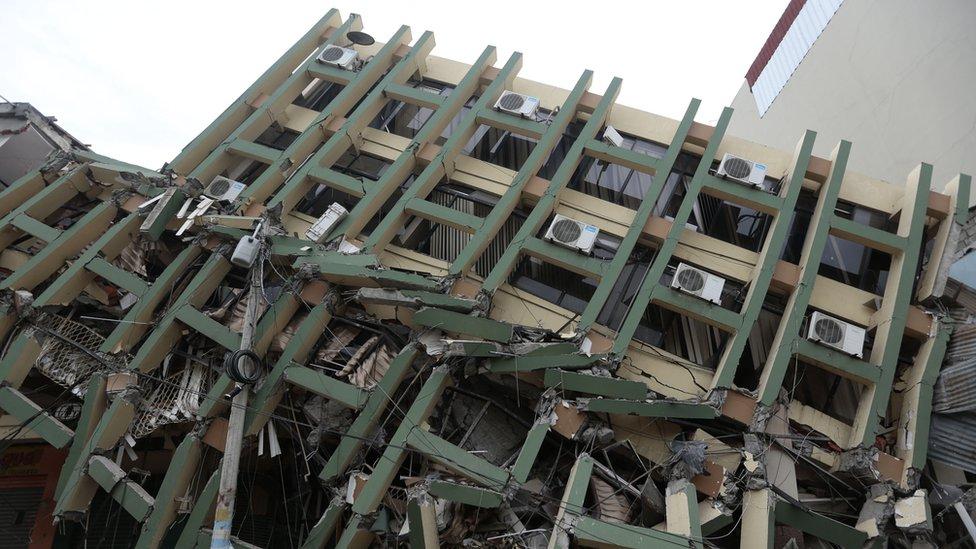 A fallen building after a powerful earthquake hit Ecuador