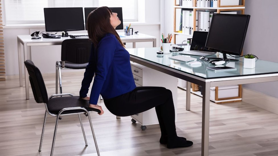 Woman stretching to the office