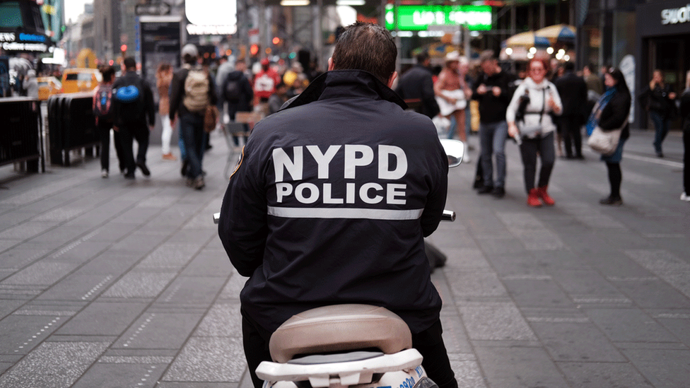 The back of a New York City Police officer on a motorbike