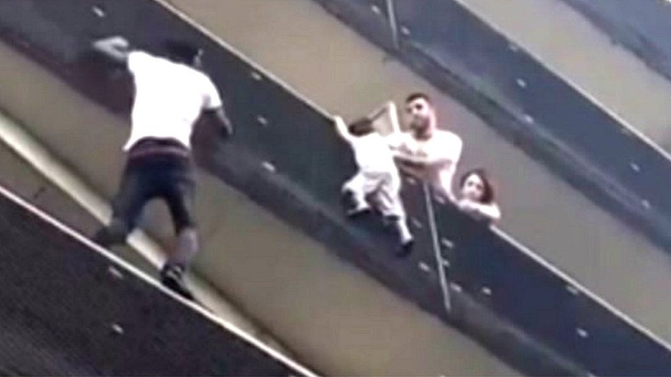 'Spiderman' balcony rescue: Father of dangling child given suspended sentence