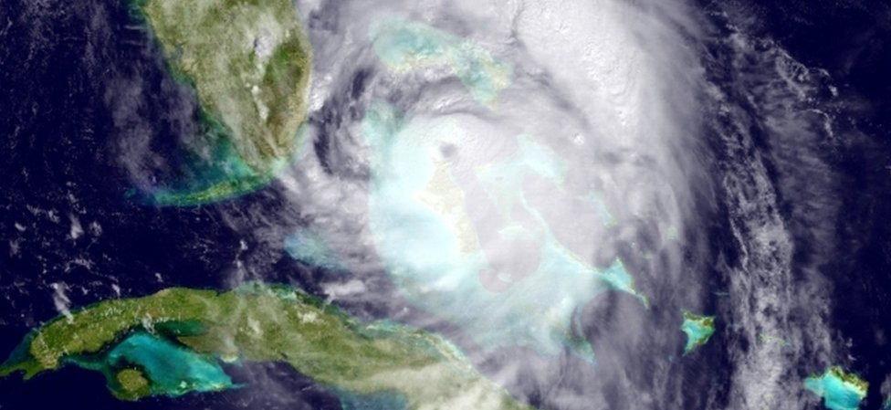 Satellite image provided by the National Oceanic and Atmospheric Administration (NOAA), shows Hurricane Matthew moving northwest of Cuba towards the Atlantic coast of southern Florida, Wednesday, 6 October 2016