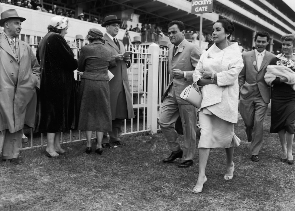 5th June 1957: British-born actress Elizabeth Taylor and her husband, film producer Mike Todd (1909 - 1958), attend Derby Day at Epsom with singer Eddie Fisher and his wife Debbie Reynolds. Fisher later left Reynolds to marry Taylor.