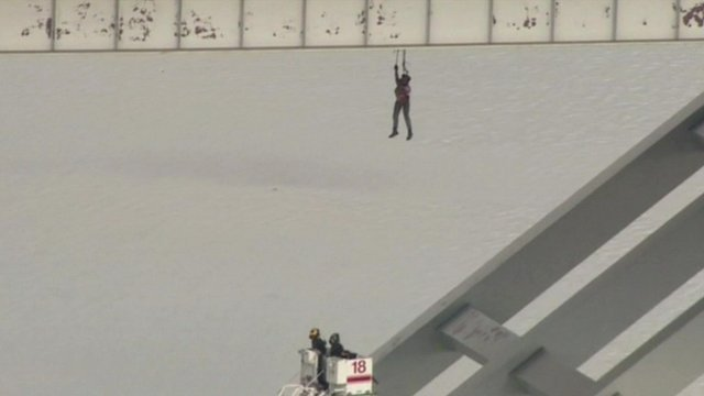 Construction worker dangling from a Houston bridge