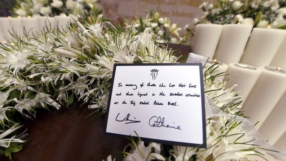 Close-up of wreath laid by royals and message